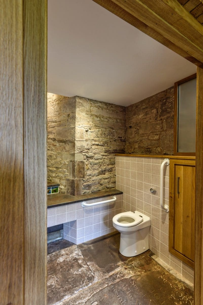 An accessible toilet, stone walls and floors inside, st Michael and all angels, church re-ordering