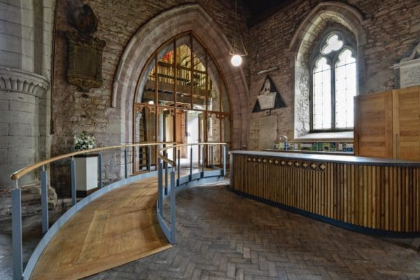 Interior of St Michaels and All Angles, a church re-ordering, image shows a ramp to the left and a kitchenette area to the right.