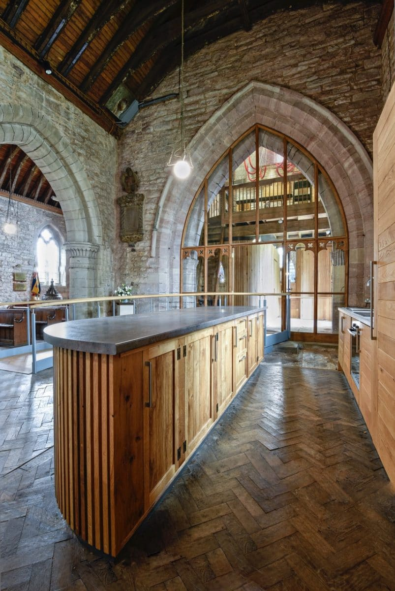 Kitchenette area in st Michaels and all angels, a timber kitchen island with a dark stone top, part of the church re-ordering.