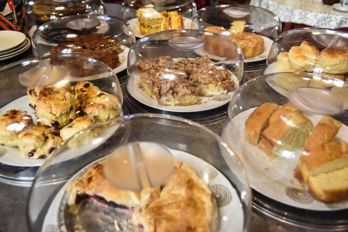 Image of home baked cakes under glass coverings, 'Take a Pew' cafe, St Micheal and All Angels, church re-ordering