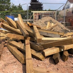 A pile of used pegging out sticks, they've been used on site for marking out digging areas - communiion architects herefiord