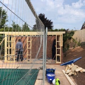 A flat roofed, timber framed pool house - only structural frame has been erected so far, communion architects Hereford