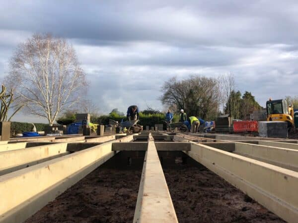 Wooden floor supports being laid for a new family house. Communion Architects, Herefordshire.