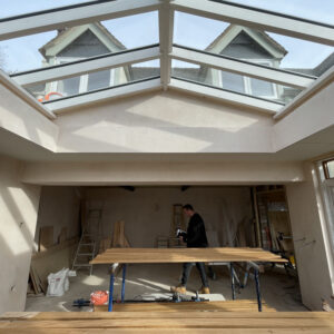An apex roof light, part of a small orangery extension. Through the roof light, two dormer windows of the house can be seen. Communion Architects, Hereford, Herefordshire.