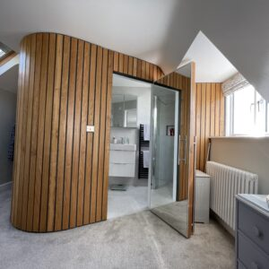 A new ensuite, curved timber walls segregate the ensuite from the bedroom, creating facilities in the bedroom without loosing space, Communion architects Hereford.