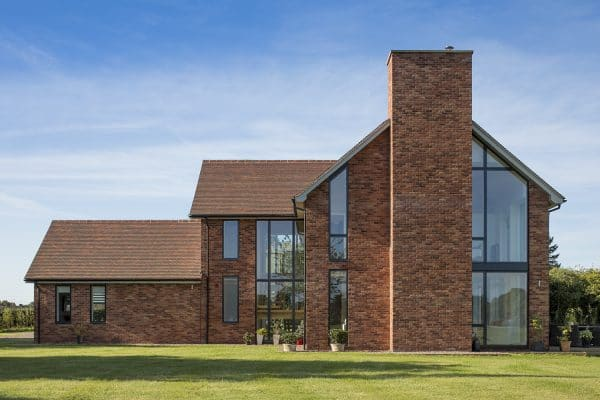 Impressive large brick and glass home